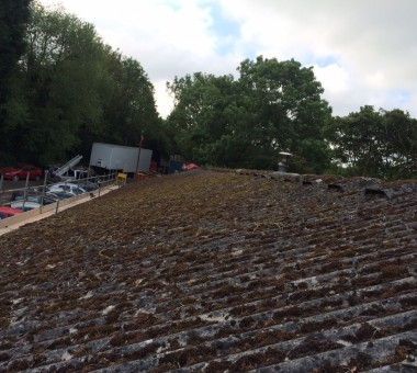 Asbestos roof before cleaning and coating by Arron Roofing Systems Ltd